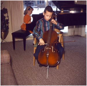 Gary performing on his Kay cello, with younger sister Barbara accompanying