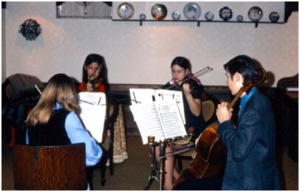 A string quartet from high school (L-R): Barbara Stucka (viola), Robin Fossum and Elizabeth Prielozny Barnes (violins), Gary Stucka (cello)